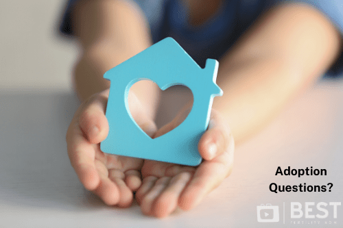 child holding a bule house shape witha heart shape in the middle missing, illustrating best fertility now adoption questions