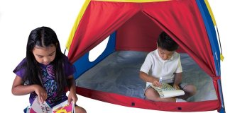 The Me Too Play Tent features a circular tunnel port