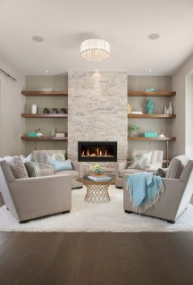 Cool Living Room Design Ideas With Fireplace To Keep You Warm This Winter13