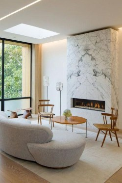 Cool Living Room Design Ideas With Fireplace To Keep You Warm This Winter16