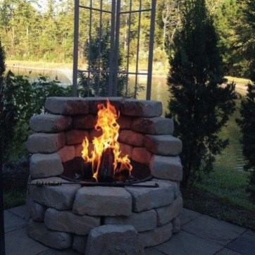 Relaxing Outdoor Fireplace Designs For Your Garden27