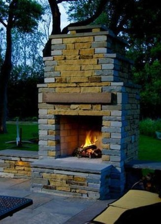 Relaxing Outdoor Fireplace Designs For Your Garden38