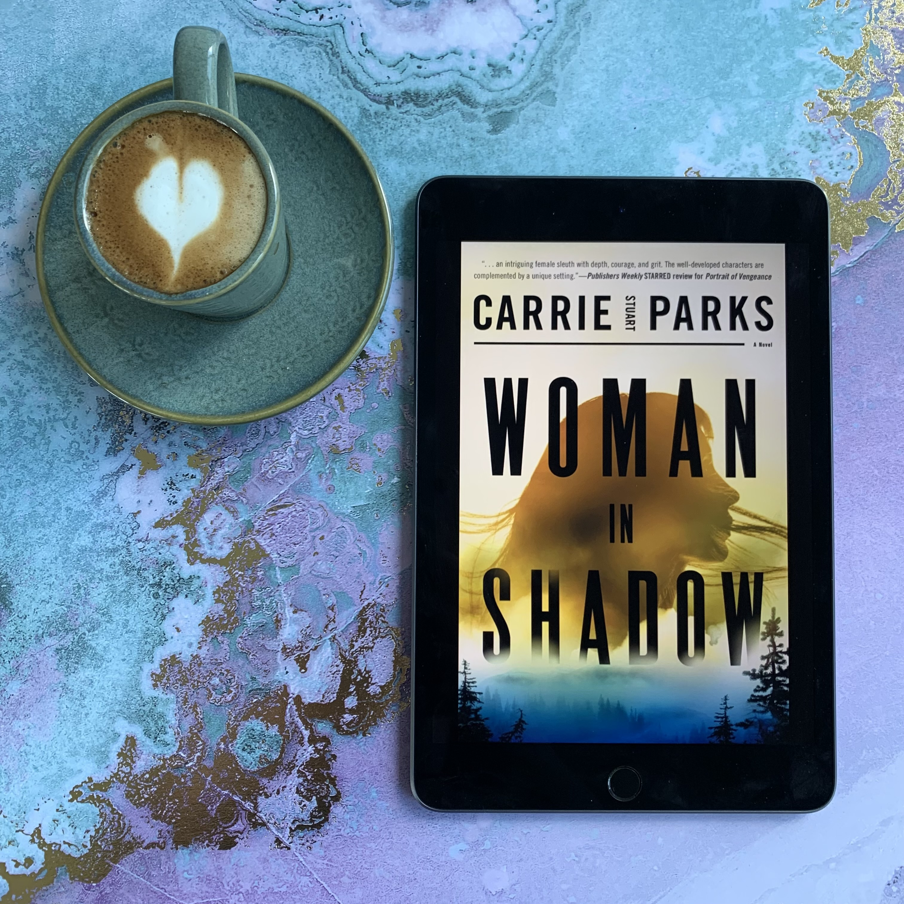 Woman in Shadow book cover and coffee with latte art