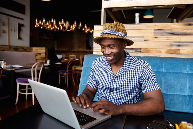 Man doing work on laptop happy