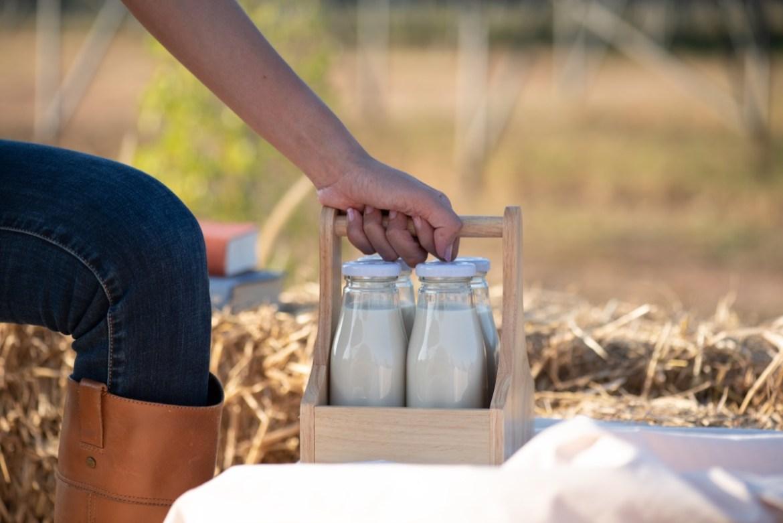 Milk woman with milk bottles