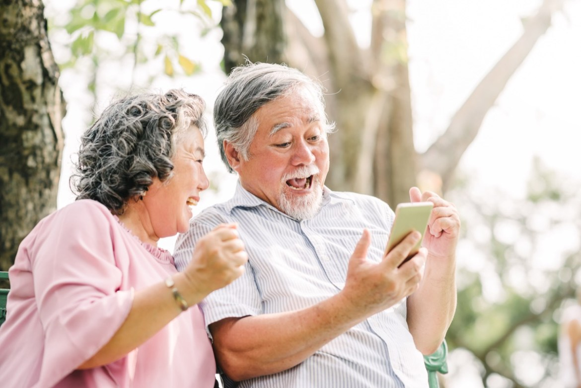 Older couple looking at a phone surprised