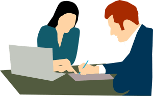 Man and woman signing contract