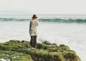 Girl thinking on a beach