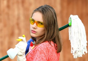 a girl holding cleaning items