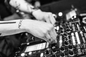 An image of a DJ playing music