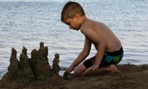 a kid making sand castle
