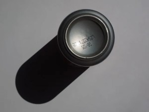 expiration date written on a can of soda.