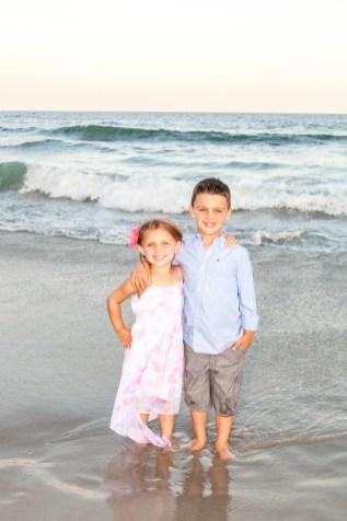 Children posing in the surf