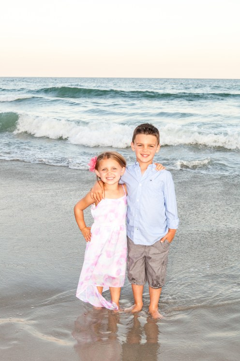 Children posing in the surf