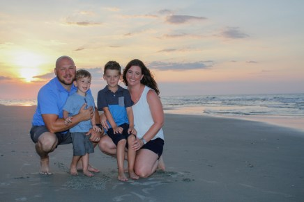 Family posing for sunrise pictures