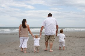 Family walking toward the surf in Myrtle Beach
