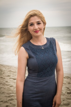 Beautiful girl getting senior portrait in Myrtle Beach