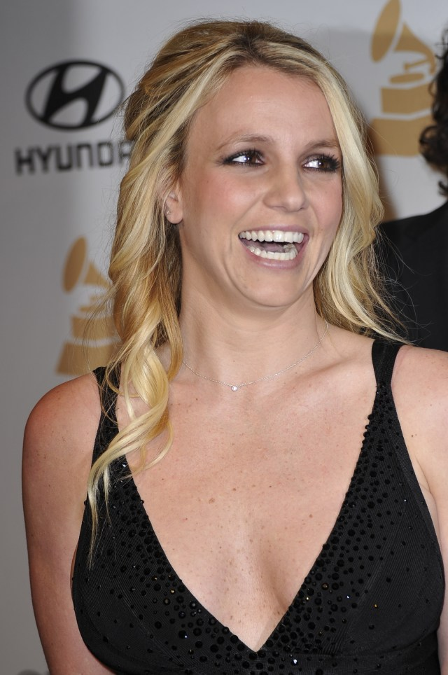 Britney Spears poses upon arrival at t