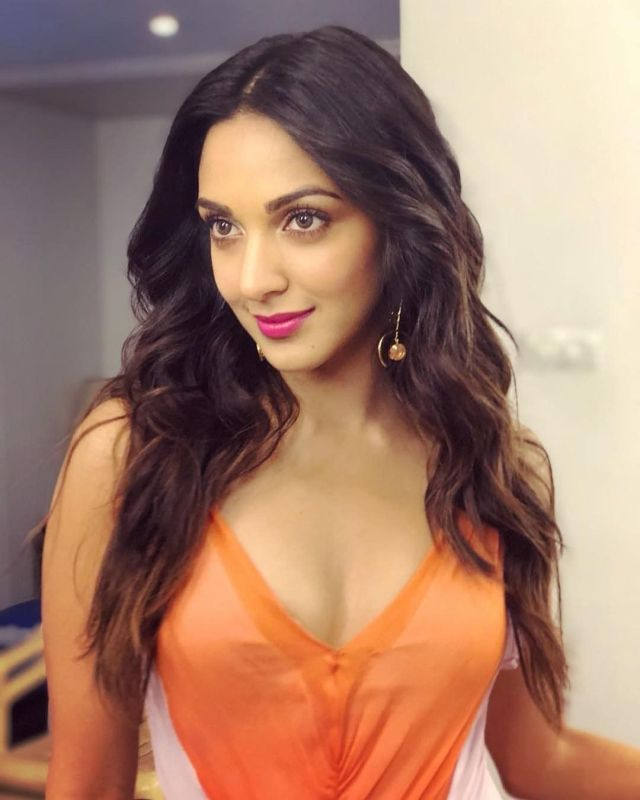 Kiara Advani Sexy Boobs Pics on Orange Dress