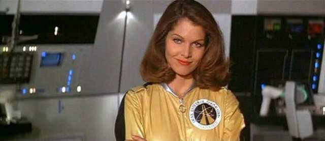 Lois Chiles yellow dress pic