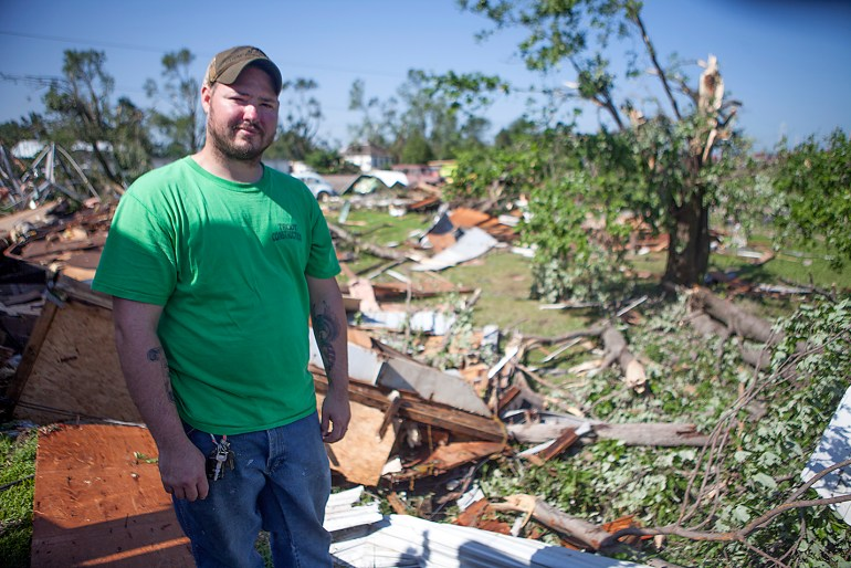 Josh Atwell of Cameron stands in front of remnants of a trailer he was restoring to move into before it was destroyed by a tornado that struck Cameron on Thursday, July 16, 2015. The entire structure was destroyed. STEVE DAVIS/The Register-Mail