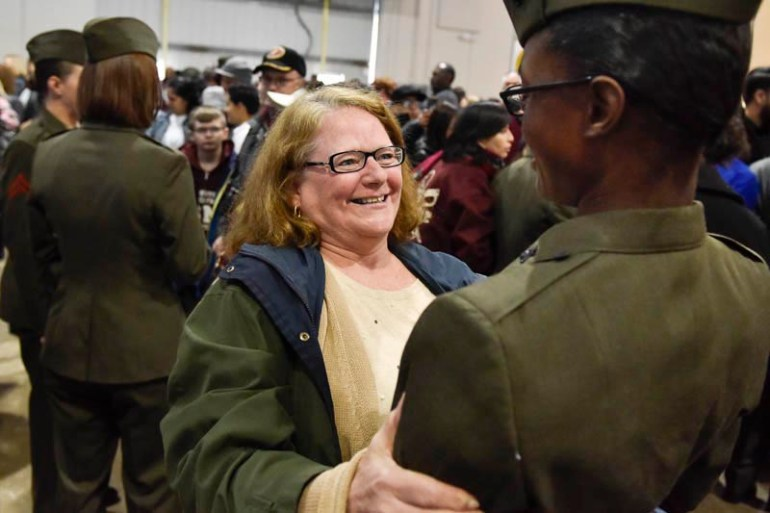Malden High School House Principal, Marilyn Slattery looks at former Malden High School graduate and now Marine Pvt Nafcerlyn Corney after her graduation on Wednesday, Feb. 25, 2015. Teachers from around New England got a chance to see what life would be like for Marine recruits during the Marine Corps Educator Workshop at Parris Island in South Carolina.