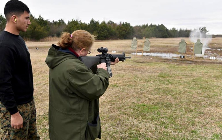 Malden High School house principal Marilyn Slattery, receives instructions on how to an M16 when teachers from around New England got a chance to experience what life would be like for Marine recruits during the Marine Corps Educator Workshop at Parris Island in South Carolina on Wednesday, Feb. 25, 2015.