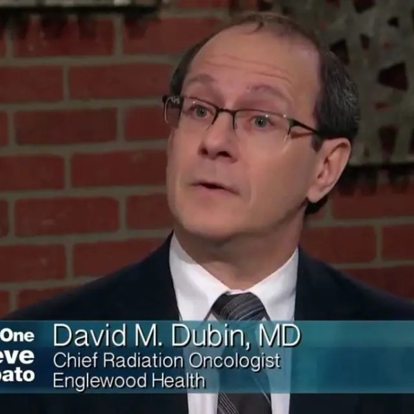 Photo of Dr. David Dubin discussing new cancer screening and cancer treatment technology