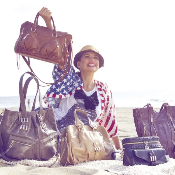 Photo of woman showing off handbags on the beach made by Crystal Kodada