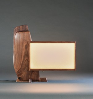 The natural rounded edge of the polished walnut balances the cantilevered rectangle of light.