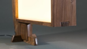 A close-up of rounded handcut dovetail and base.