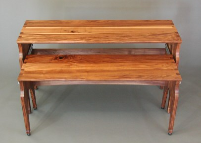 The client's idea was to design a desk that a whole electronic piano could slide out from under. A pull-out tray, like those for computer keyboards, would have been too flimsy, so I designed two desks that nest, with one on wheels.