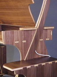 """Joinery made on a CNC machine has all these funny """"dogbone"""" shapes, because the router can't cut square inside corners. The strangely shaped mortises become a design element."""