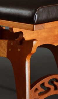 Delicate curves and exposed joinery.