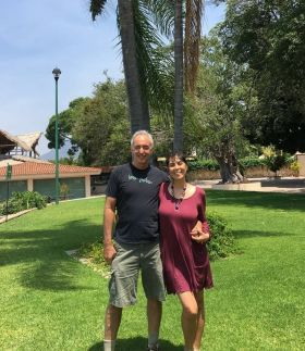Jet Metier and Chuck Bolotin on the grass in Mexico
