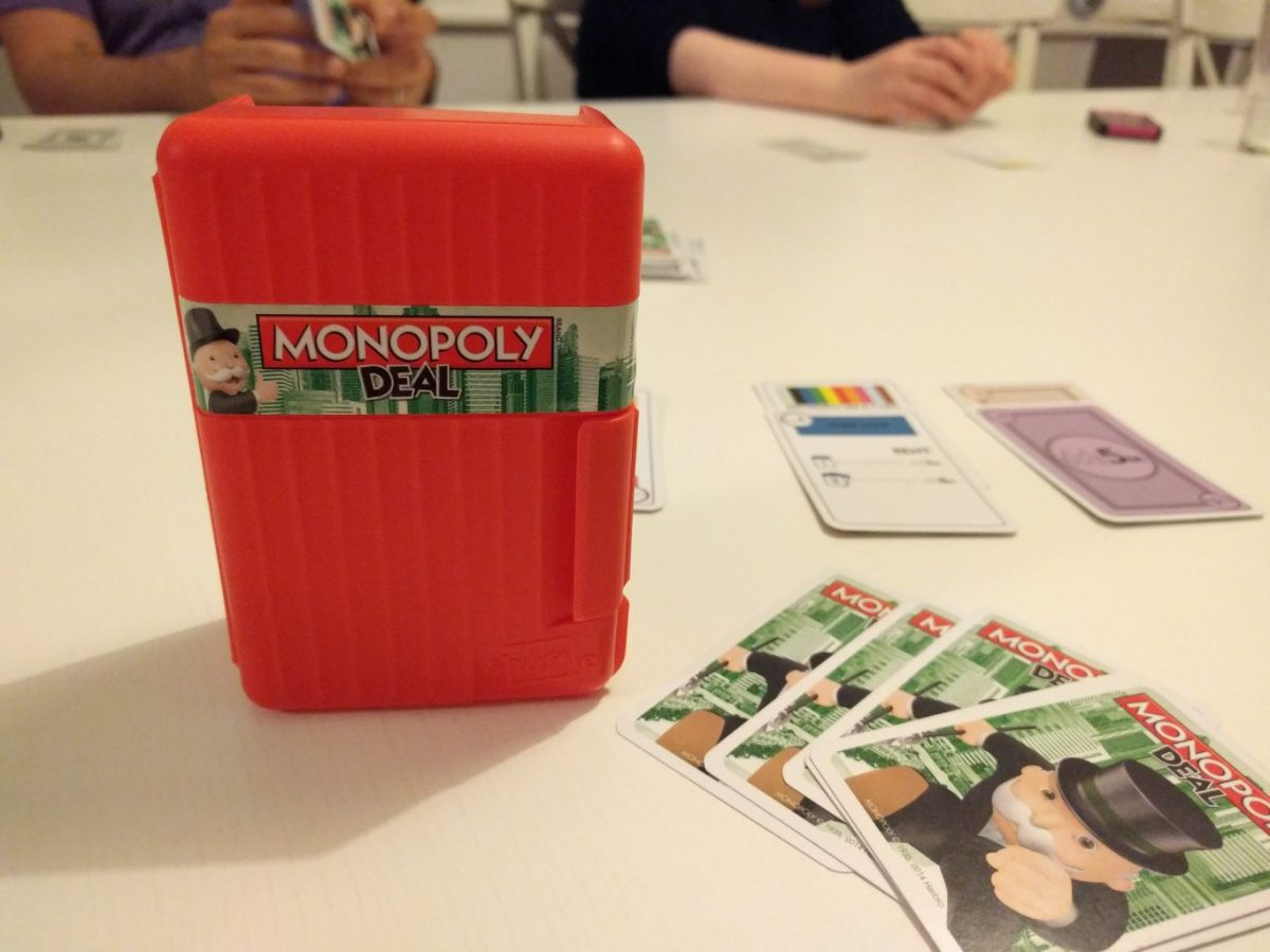 Monopoly Deal box and cards