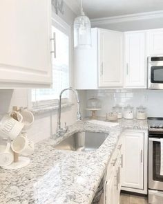 72 Beautiful Kitchen Countertop Ideas with White Cabinets Look Luxurious 2262