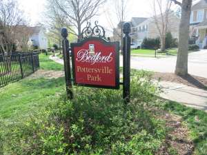 Pottersville Park Sign with Cardington Lane Houses in Background, Best Raleigh Neighborhoods, North Raleigh, Bedford
