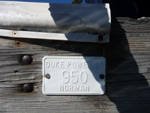 Photo of an older dock permit fixed on a Lake Norman dock