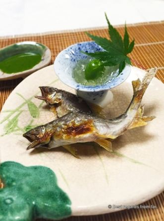 Grilled sweet fish with a salty green sauce.