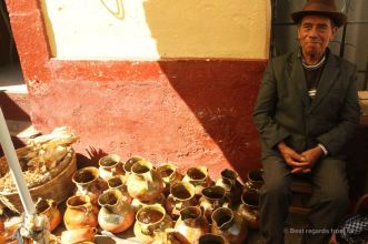 A proud potter on the market of Totonicapan, Guatemala