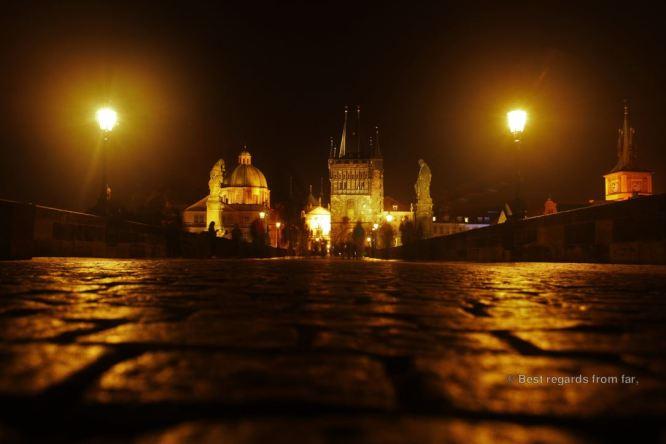 Strolling Charles Bridge in Prague, Czech Republic, at night