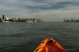 The Manhattan skyline on the left with the Chelsea Piers in the front, New York City