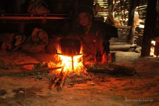 An old lady in her kitchen, Akha village trekking, Laos