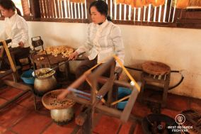 Boiling and spinning the golden silk cocoons, Siem Reap, Cambodia
