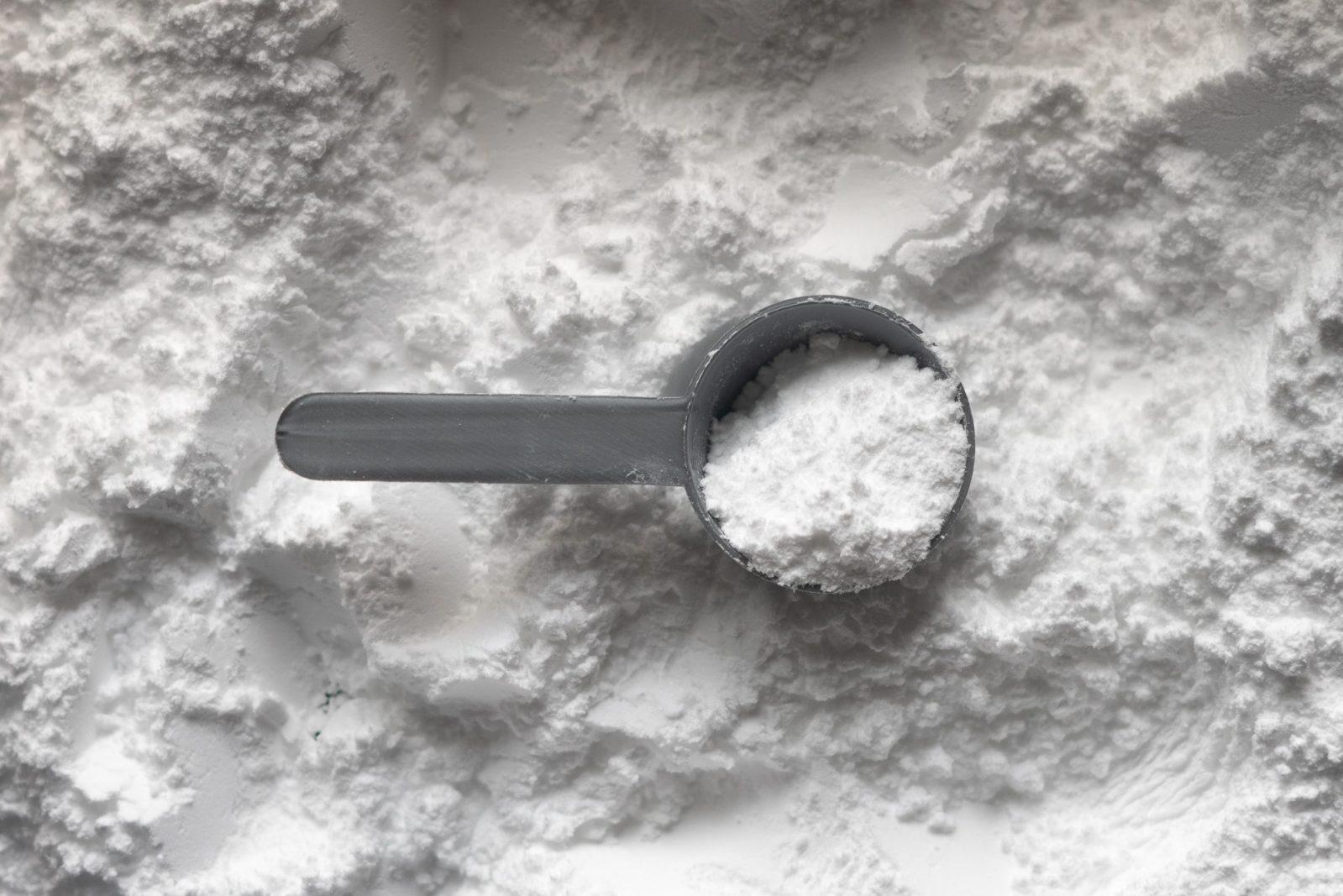 Creatine powder with scoop