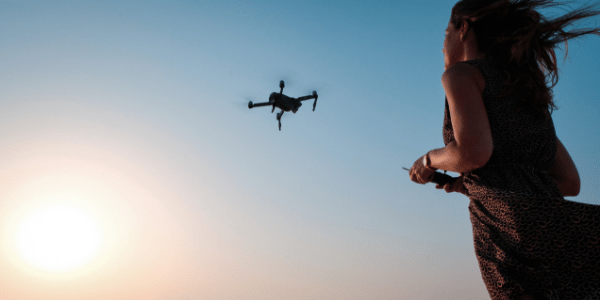 Image of Woman Flying Drone from Best Travel Drones Image 5