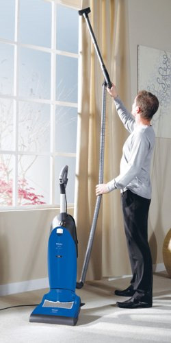 The Miele S7210 Twist is one of the most in demand upright vacuum cleaners from this popular brand. Built to last and meant as a true investment, the Miele brand has established itself in the area of top of the line vacuums.  Save $50 off the Twist right now at Amazon. Daily Use For day to day use, the Miels Twist is very easy to use. First it has a patented swivel technology that makes it easy to steer. This is practically essential in any upright vacuum, as they can be quite cumbersome to maneuver, especially around corners and furniture. Not only can it move in any direction, it can also lay flat to get under low furniture like beds and couches.  To make it even easier to steer, push and pull, the wheels on the front rotate a full 360 degrees, meaning it really does swivel. The wheels are also non-marking, so they won't leave smudges on hardwood floors and linoleum.  As far as the floor types the Miele S7210 works best for, it works very well on them all. Instead of having a switch or dial you need to flip or turn to change the height of the base plate, the adjustment for height is completely automatic. In other words, the Twist detects the type of carpet of bare floor and adjusts accordingly.  You can also easily turn off the roller brush so small bits won't get flung around on your hardwood or other bare floors. (If you have a kitty litter box in the house, you'll really appreciate this feature.) This will also protect your finely finished bare floors from getting scratched by the brush.  One of the other features users comment on in their reviews is something that is complained about quite a bit in other uprights with an extension hose and tools like the Shark Rotator and Navigator. That is that the machine has a tendency to want to tip over when the hose is stretched out all the way. Miele has thought of this and incorporated an anti-tipping device so the machine remains stable even when you stretch out the hose.  Mechanics miele s7210This popular vac has a p