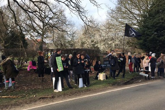 Protesters group outside the farm in Lincolnshire. Credit: Lincolnshire Live/Reach
