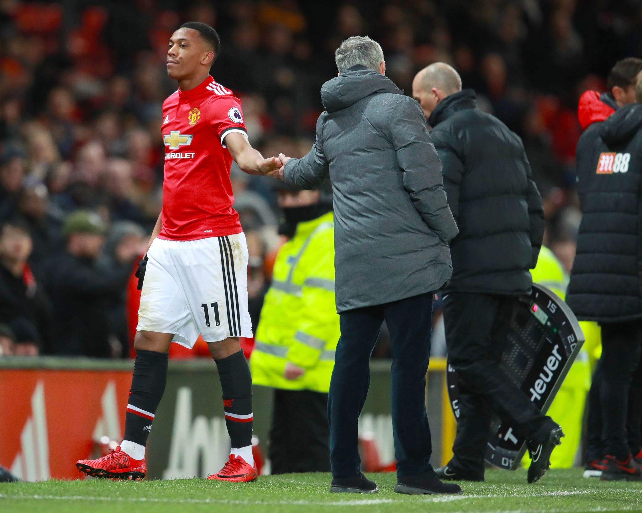 Mourinho shakes hands with Martial. Image: PA